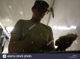 U.S. Army Spc. Dustin Freeman, a food services specialist with Headquarter  and Headquarters Company, Special Troops Battalion, Sustainment Brigade,  1st Infantry Division, prepares a meal at evening chow for services members  at