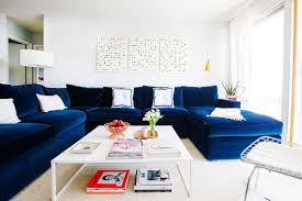 chic living room in white with bright navy blue sectional sofa ideas