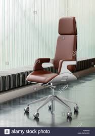brushed metal and brown leather luxury office chair on dark steel parquet floor design furniture interstuhl silver 362s