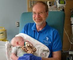 Bruce Erickson Cuddling And Caring For Newborns Springs