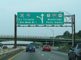 traveling the exit 129 ramp drivers pass over the turnpike and under main street before the split with ramps to interstate 95 and the u s 9 freeway