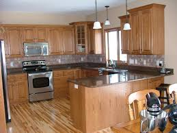 dark counters with wood cabinets kitchen countertop backsplash
