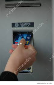 Woman Hand On A Bank Atm