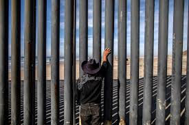 a man looks towards the united states through a fence in tijuana mexico in november 2018 alejandro cegarra bloomberg