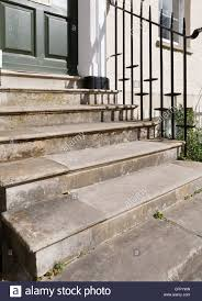 front door stepsOld stone steps leading to front door UK Stock Photo Royalty Free