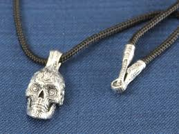 above william henry studios renegade necklace the skull is sculpted from sterling silver paying homage to the sugar skull tradition from mexico