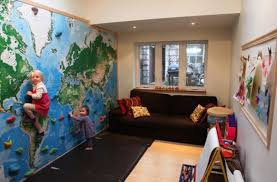 View in gallery A climbing wall with right protection is a great idea in  the kids' playroom