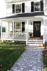 white with black front door and black shutters