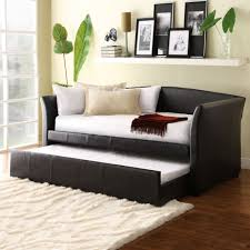 maximizing small living room spaces with black leather sleeper sofa and white cushions plus fold out bed drawer under wood wall mounted display furniture