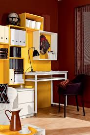 compact office. Compact Home Office In A Living Room With Bright Yellow Storage Wall. T