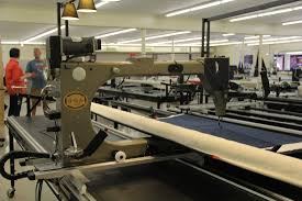 Used Longarm Quilting Machines - Accomplish Quilting & 2002 Gammill Optimum with Statler Stitcher 30-12 on 14' frame with poly  stand top and zippered leaders. Adamdwight.com