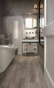 such wood look floor tiles are perfect for a bathroom where it s often humid