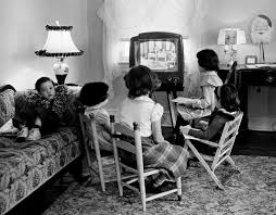 black kids watching tv. children watch tv in 1953. less-affluent youngsters spend more than three hours black kids watching tv