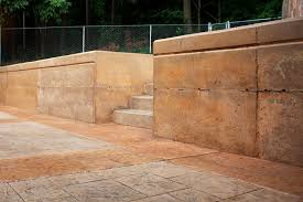 stamped colored concrete patio retaining wall