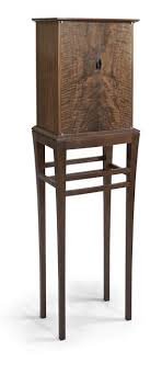 wooden design furniture. woodworker ian kirk saw the hourglass figure in grain as a design opportunity for this walnut cabinet wooden furniture