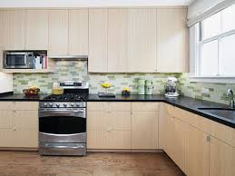Granite With Cream Cabinets Interesting Cream Kitchen Cabinet With Black Appliances Colors And