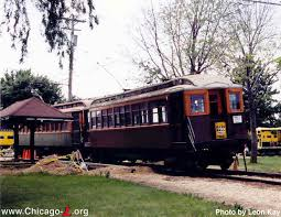 car 1808 leads a two car train old wood bod l cars during the illinois railroad museum s annual trolley parade on july 4 2003