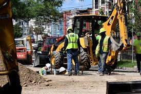 an albany water department crew works on elberon place near the site of a sinkhole on