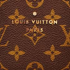 the classic louis vuitton logo embellished on monogrammed leather