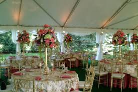 tent wedding with beautiful fl centerpieces
