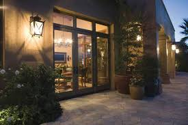 lighting schemes. Wall-mounted Lanterns At A Door Leading To The Patio Or Outdoor Space Will Provide Lighting Schemes