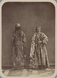 le central asian women s adornment and clothing a woman with long braids decorated with beads and another wearing an ortment of jewelry
