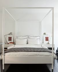 Chic bedroom features white canopy bed, Ikea Edland Bed, dressed in ...
