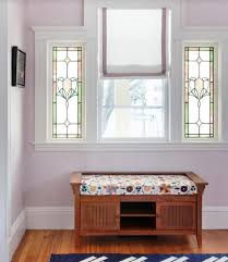 lovely flower stained glass windows decoration in a bright foyer with wooden storage bench also white