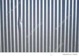 corrugated metal panel with vertical ridges background