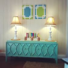Tiffany blue paint brushed over with an oak stain gives this credenza it's  modern vintage look