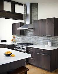 gray backsplash dark cabinets. Dark Cabinets Matched With Grey Backsplash And White Granite Countertops Nice Speckled For Gray