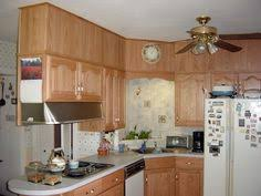 baskets above kitchen cabinets for the home pinterest