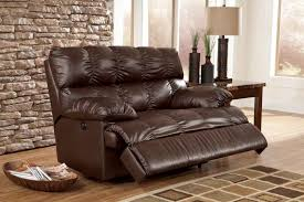 dark brown leather recliner chair. family room with dark leather relaxing wide recliner sofa added brown stained wooden side table lamp combined stone wall accent motorized chair