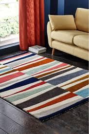 next broken stripe bright rug orange