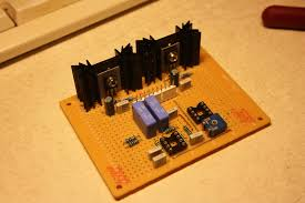 i had some of them left over from old projects the two power transistors mounted on the heatsinks work as linear voltage regulators to convert the power