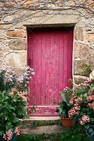 Bright Pink Paint Bright Pink Paint Wood Door With Crooked Archway On An Old Stone
