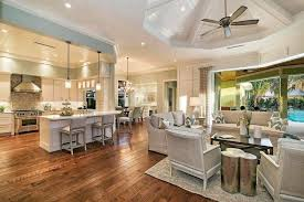 matching light gray counter chairs and sofas with beadboard paneled kitchen ceiling and living room octagonal
