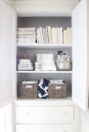 white linen closet organization