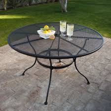 black wrought iron furniture. Round Wrought Iron Patio Dining Table By Woodard - Textured Black | Hayneedle Furniture