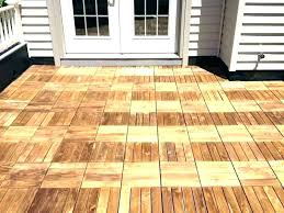 interlocking patio tiles over grass wooden outdoor tile concrete wood full image for garden on polywood