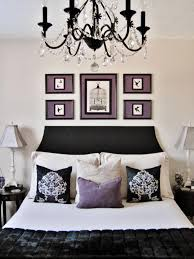 interior excellent black white purple bedroom with black crystal chandelier over white bed sheet also