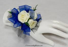 prom 003 35 plus tax and delivery cly white rose wrist corsage with bright blue ribbon black ribbon and studded wrist band