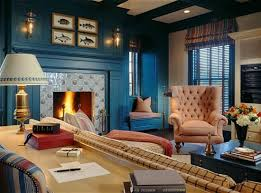 dark blue walls in living room with navy blue coach and fresh green accent