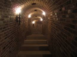Arched Brick Underground Tunnel Passageway With Concrete Stairs - Creepy basement stairs