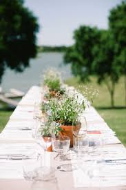 Rustic table setting with potted plant centerpieces. Photo by Jess Barfield  Photography. www.