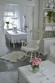 `Just our style..love the white clean Shabby Chic in these rooms.