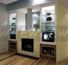 glass shelves in lighted alcoves either side of fireplace in a nineties living room with a vintage television