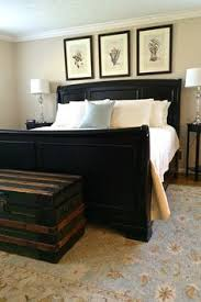 white bed black furniture. sw stucco paint master bedroom with a jet black sleigh bed from barn lush super comforable white bedding and walls painted in vintage patina furniture w