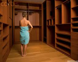 Woman Standing In Empty Closet