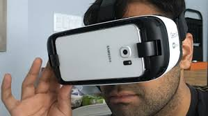 samsung virtual reality headset. cbc\u0027s anand ram tries out the samsung gear vr heaset. it has straps to keep virtual reality headset e